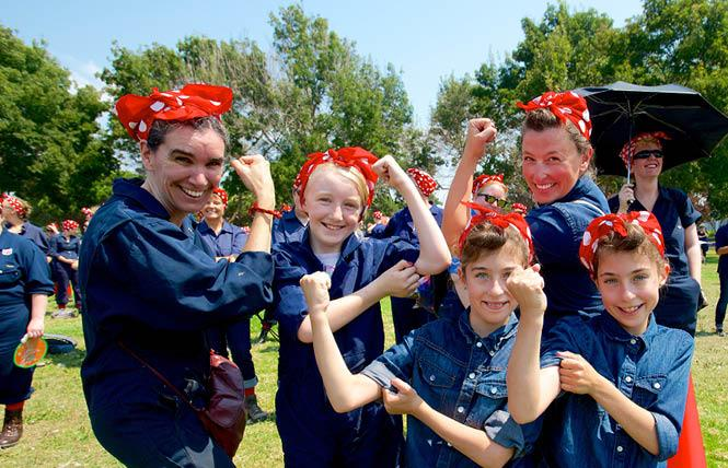 "Mother and daughter ""Rosie's,"" from left, Kiki Jewell, Charlotte Jewel, Amy Wright, Gabby Wright, and Ally Wright, celebrated Rosie the Riveter at the Rosie the Riveter/WW II Home Front National Historic Park in 2015. Photo: Jane Philomen Cleland"