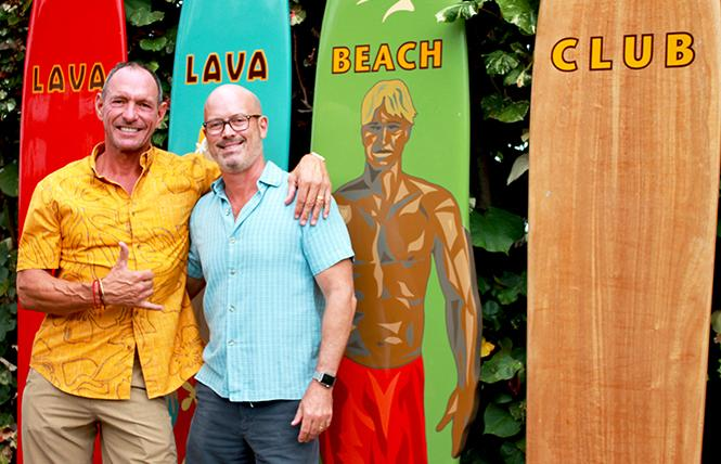 Eric von Platen Luder, left, and his husband, Scott Dodd, stand outside Lava Lava Beach Club, one of the restaurants and lodging businesses they own under the Luana Hospitality Group on the Island of Hawaii and Kauai. Photo: Heather Cassell
