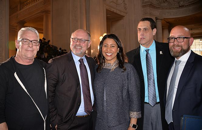 Cleve Jones, left, joined Jonathan Moscone, Mayor London Breed, Stuart Milk, and Supervisor Rafael Mandelman in speaking at City Hall Tuesday, the 40th anniversary of the assassinations of mayor George Moscone and Harvey Milk. Photo: Bill Wilson