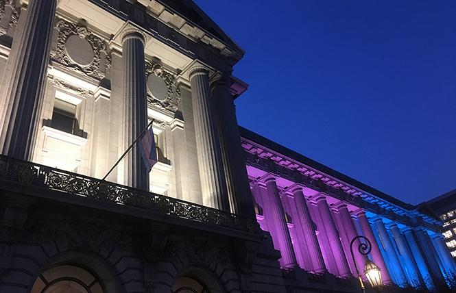 The transgender flag flies over the Mayor's Balcony at City Hall as the building is lit for the 2018 Transgender Day of Remembrance on November 20. Photo: Christina A. DiEdoardo