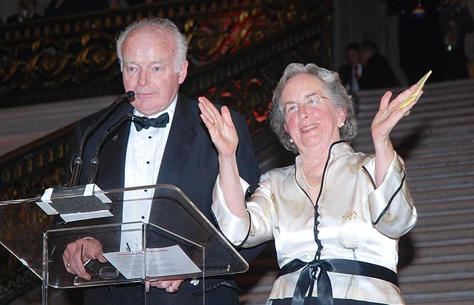 Sam and Julia Thoron acknowledged the cheers of the crowd following their acceptance of the Equality Award at Equality California's annual dinner in 2010. Photo: Rick Gerharter