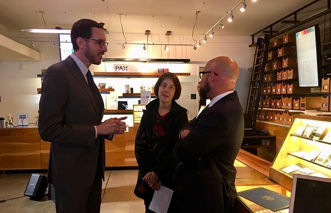 State Senators Scott Wiener, left, and Nancy Skinner talk with San Francisco Supervisor Rafael Mandelman talk ahead of a news conference at SPARC November 29. Photo: Sari Staver