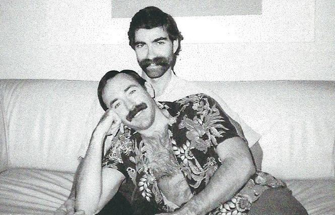 Race Bannon in the lap of his late partner, Kevin Lockwood, in happier days before Kevin's passing from AIDS in 1992.  photo: Race Bannon