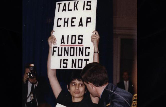 Lesbian activist Urvashi Vaid protests George H.W. Bush's speech on AIDS in 1990. Photo: Courtesy AP