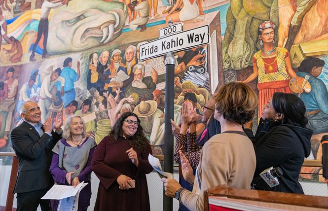 City College of San Francisco Chancellor Mark Rocha, left, joined faculty member Leslie Simon; Angelica Campos, vice president of the Associated Students; Supervisor Norman Yee, partially obscured; and City College Trustee Shanell Williams, second from right, for the official unveiling of Frida Kahlo Way December 7. Photo: Jane Philomen Cleland