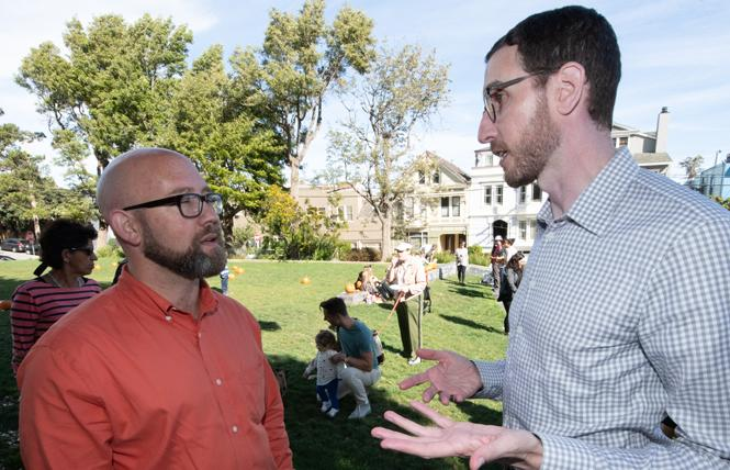 District 8 Supervisor Rafael Mandelman, left, and state Senator Scott Wiener talk at a fall pumpkin-carving event at a public park in Noe Valley. Photo: Jane Philomen Cleland
