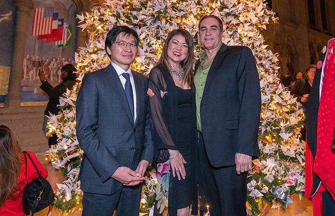 Kazuhiro Inyu, deputy consul general of Japan, left, joined origami expert Linda Mihara and Rainbow World Fund Executive Director Jeff Cotter at the World Tree of Hope lighting ceremony at Grace Cathedral December 3. Photo: Jane Philomen Cleland