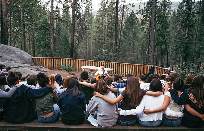 Camp Tawonga participants gather around the campfire in camaraderie and song in 2018. Photo: Courtesy Camp Tawonga