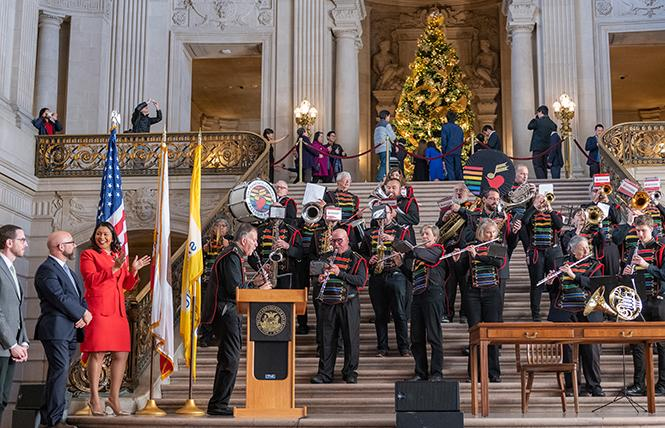 Mayor London Breed, left, claps during a performance by the San Francisco Lesbian/Gay Freedom Band after she signed an ordinance December 18 making it the official band of the city. Photo: Jane Philomen Cleland