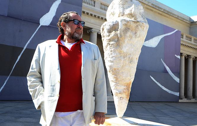 "Julian Schnabel stands amidst his paintings and sculptures at the Palace of the Legion of Honor, site of ""Symbols of Actual Life."" Photo: Rick Gerharter"