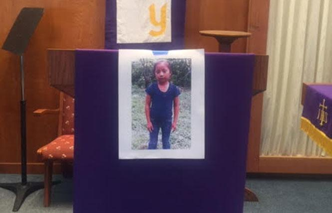 A photo of Jakelin Amei Rosmery Caal Maquin, who died in Customs and Border Patrol custody earlier this month, was displayed at the Island United Church in Foster City. Photo: Courtesy Jim Mitulski