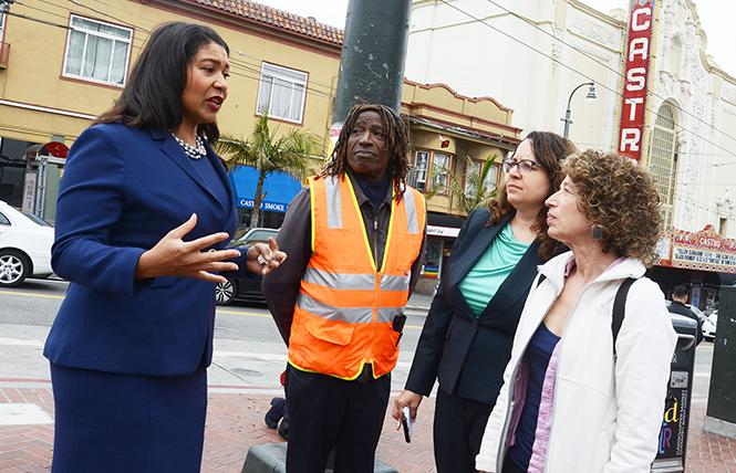 During a walking tour of the Castro in August, Mayor London Breed, left, heard neighborhood concerns from Ken Jones, Sandra Zuniga from San Francisco's Fix-It Team, and Andrea Aiello, executive director of the Castro/Upper Market Community Benefit District. Photo: Rick Gerharter