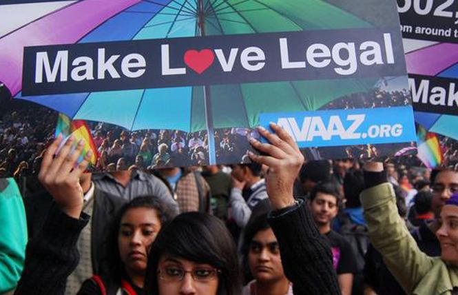 Demonstrators wait outside of India's Supreme Court in Bangalore September 6 for the judges' decision on Section 377, the penal code that criminalized homosexuality in India. Photo: Courtesy IANS