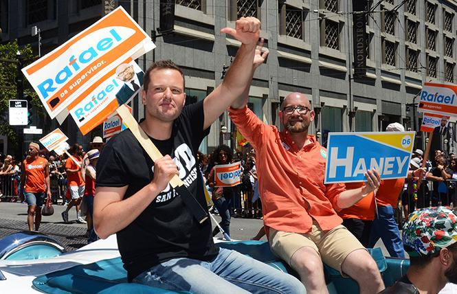 Incoming District 6 Supervisor Matt Haney, left, and gay District 8 Supervisor Rafael Mandelman, shown in last year's Pride parade, can work together on projects benefiting the LGBT community this year. Photo: Rick Gerharter