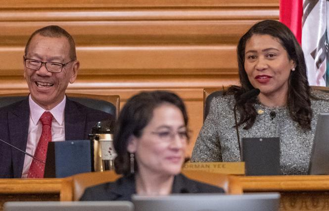 New San Francisco Board of Supervisors President Norman Yee, left, received congratulations from Mayor London Breed Tuesday. Photo: Jane Philomen Cleland