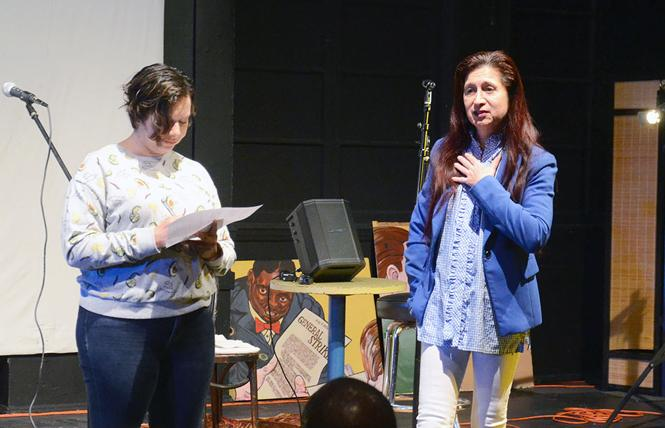 Isabella Torres, right, speaks of the importance of El/La Para TransLatinas for Spanish-speaking transgender people during a musical/social event informing the community about the status of the Redstone Labor Temple Building, where the organization has its meeting rooms. Photo: Rick Gerharter