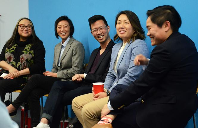 """Panelists share a laugh during """"Navigating the Queer Asian-American and Immigrant Experience,"""" a panel sponsored by GAPA and the United Democratic Club. Panelists, from left, included Cecilia Chung, Cynthia Wang, Phil Kim, Mandy Lee, and Michelle Meow, the moderator. Photo: Rick Gerharter"""
