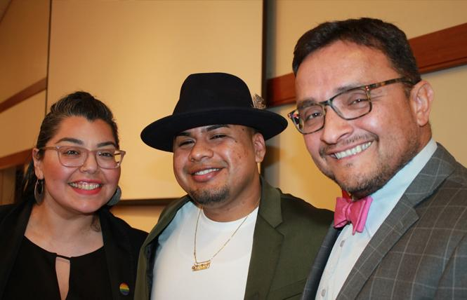 Maribel Martinez, left, director of Santa Clara County's Office of LGBTQ Affairs, joined undocumented queer poet Yosimar Reyes and David Campos, deputy county executive, at the Beacon of Light Awards ceremony in Campbell January 25. Photo: Heather Cassell