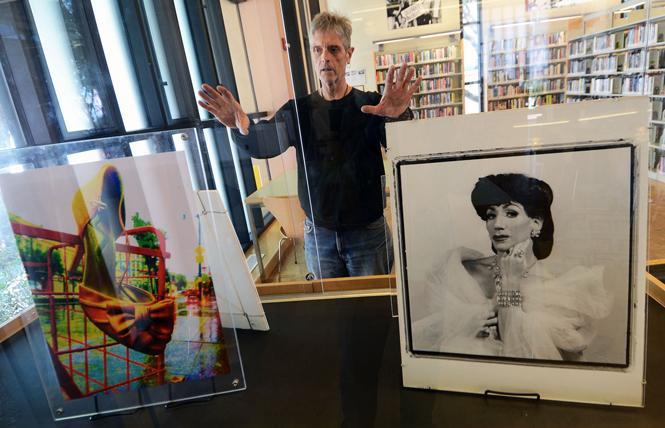 "Billy Douglas installed his photographs at the Harvey Milk Branch of the San Francisco Public Library for 2017's ""Windows for Harvey"" exhibit. Photo: Rick Gerharter"