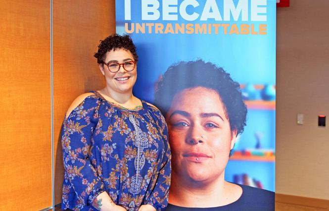 Spokesmodel Rikki Vick, born with HIV and living with undetectable virus, stands in front of a poster of herself that is part of Santa Clara County's new U=U campaign. Photo: Jo-Lynn Otto