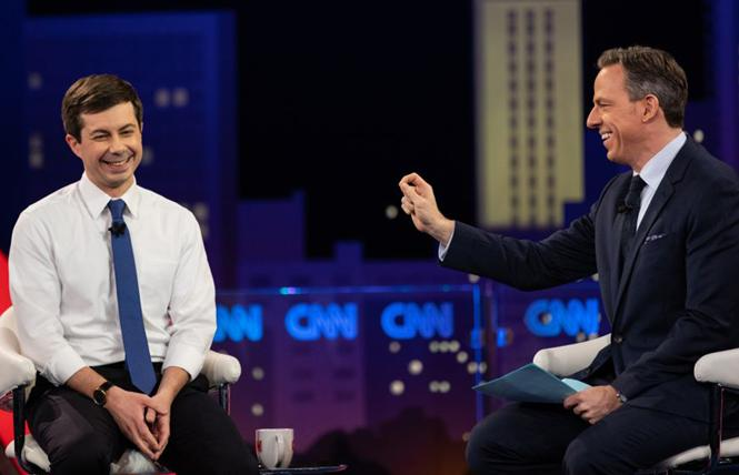 Democratic presidential candidate Pete Buttigieg, left, takes questions from moderator Jake Tapper at a CNN town hall in Austin, Texas. Photo: Courtesy CNN