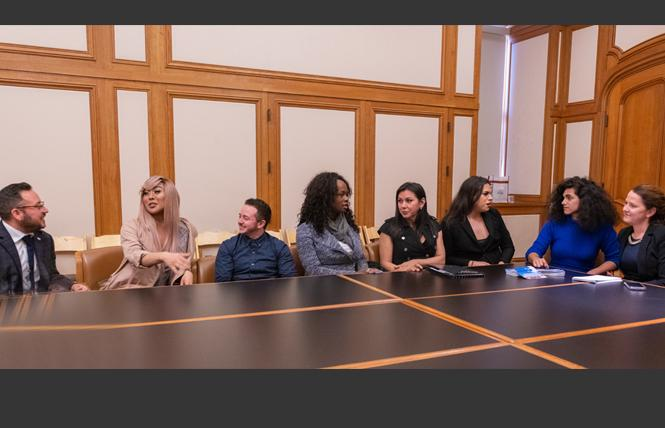 Maceo Persson, left, discusses the new Our Trans Home — San Francisco campaign with Melanie Ampon, JM Jaffe, Akira Jackson, Jessy D'Santos, Rexy Amaral Tapia, Shane Zaldivar, and Clair Farley during an April 4 debriefing in the mayor's conference room at City Hall. Photo: Jane Philomen Cleland