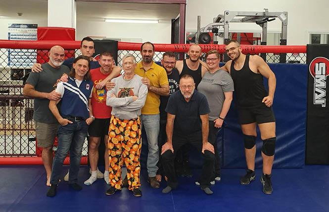 Wrestlers in Sydney, including Roger Brigham, fifth from left, gather at a clinic. Photo: Courtesy Andrew Farrell