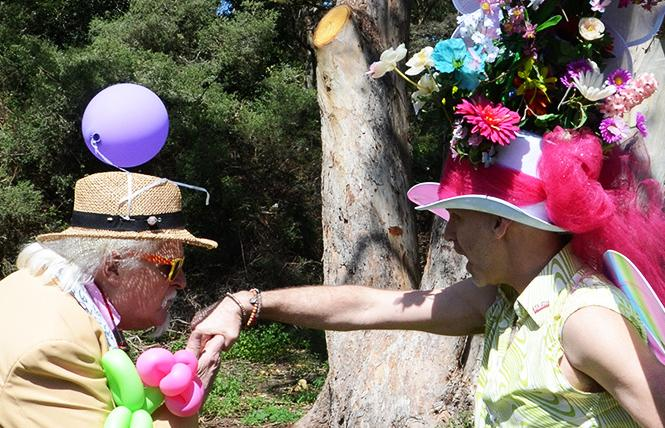 Miguel of Les Noche, left, kisses the hand of the Easter bonnet contest winner, Todd Atkins-Whitley, at the 2018 Sisters of Perpetual Indulgence's annual Easter celebration that was held in Golden Gate Park. Photo: Rick Gerharter
