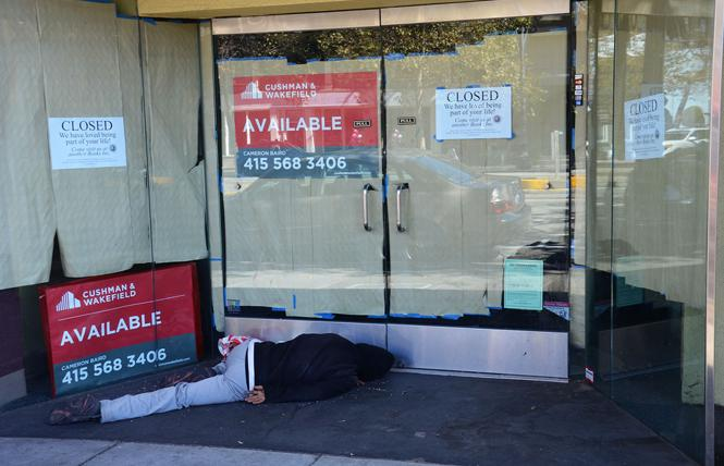 A person sleeps in the doorway in the Castro in this 2016 file photo. Photo: Rick Gerharter