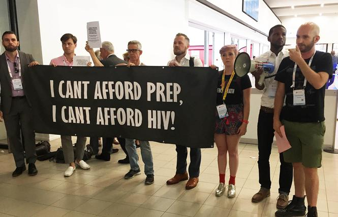 James Krellenstein, right, with the PrEP4All coalition, speaks during a demonstration at the International AIDS Conference in Amsterdam last year. Photo: Liz Highleyman