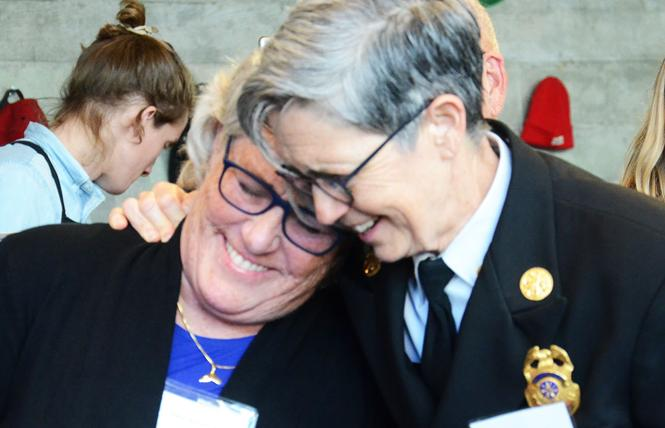 Retired San Francisco Department of Emergency Management head Anne Kronenberg, left, hugs Deputy Fire Chief Jeanine Nicholson at a recent Golden Gate Business Association mixer. Photo: Rick Gerharter