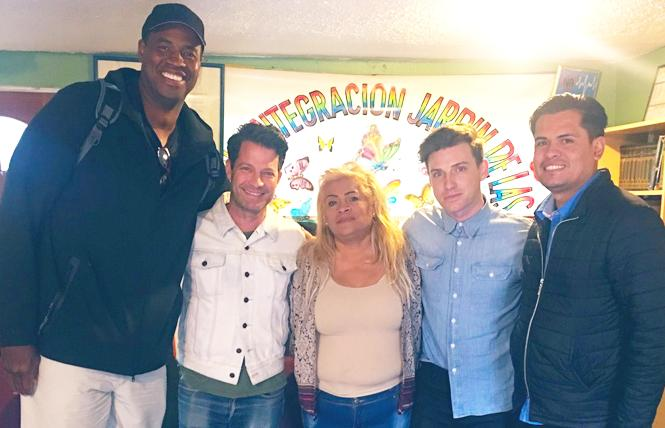 Retired NBA player Jason Collins, left, joined celebrity interior designer Nate Berkus; Yolanda Rocha, director of Casa Jardin de las Mariposas; Berkus' husband, designer Jeremiah Brent; and Jaime Antonio Marin Rocha, who also works at the Casa Jardin shelter. Photo: Courtesy Equality California