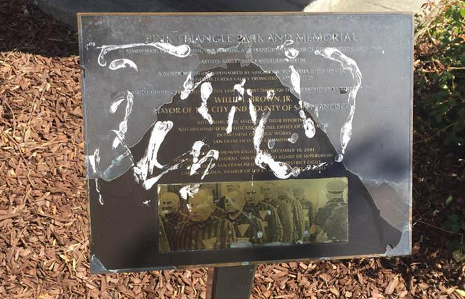 The plaque at Pink Triangle Park and Memorial was discovered vandalized Wednesday morning. Photo: Gerald Abbott