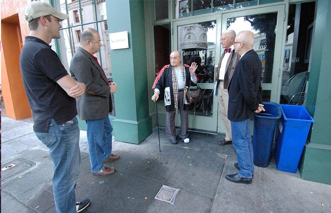 Standing in front of the site of the Black Cat bar in October 2013, Jose Sarria, center, reminisced about his time at the bar to, from left, an unidentified man, Don Berger, John Newmeyer, and then-reigning Emperor Michael Dumont. The occasion was the installation of a plaque, seen here in the sidewalk, honoring the significance of the bar to San Francisco's LGBT history. Photo: Rick Gerharter