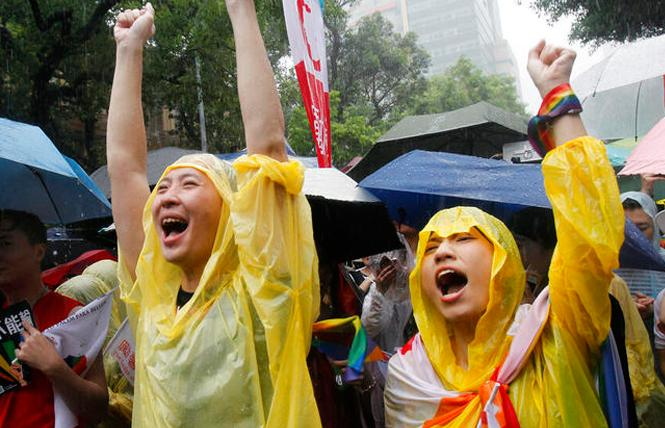 People celebrate the passage of a same-sex marriage bill May 17 outside of Taiwan's Legislative Yuan in Taipei. Photo: Courtesy AP