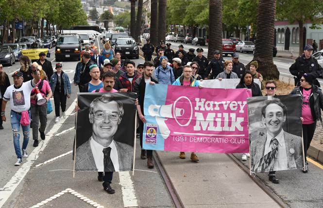 Marchers commemorated the 40th anniversary of the White Night riots Tuesday, May 21, and walked to City Hall carrying pictures of then-mayor George Moscone, left, and supervisor Harvey Milk, who were assassinated by disgruntled ex-supervisor Dan White. Photo: Gooch