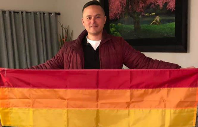 Gay Dublin City Councilman Shawn Kumagai holds a Pride flag he hopes will soon fly in front of the East Bay city's City Hall. Courtesy: Facebook