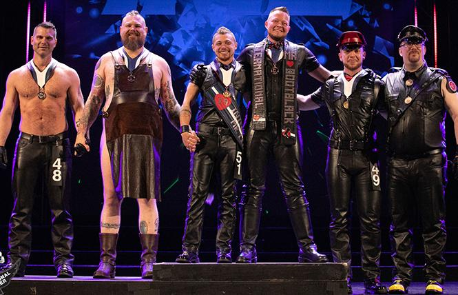 IML/IMBB winner's podium (left to right): Jawn Marques, first runner-up IML; Geoff Millard, first runner-up IMBB; Jack Thompson, winner IML; Kriszly de Hond, winner IMBB; Fionn Scott, second runner-up IML; and Sparkie, second runner-up IMBB. photo: International Mr. Leather