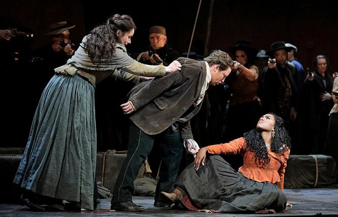 "Anita Hartig as Micaëla, Matthew Polenzani as Don José, and J'Nai Bridges in the title role of Bizet's ""Carmen."" Photo: Cory Weaver/San Francisco Opera"