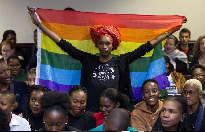 Activist Kat Kai Kol-Kes holds a LGBTQ pride flag inside Botswana's high court on Tuesday, where lawmakers overturned a law that criminalized same-sex relations. Photo: Courtesy CNN