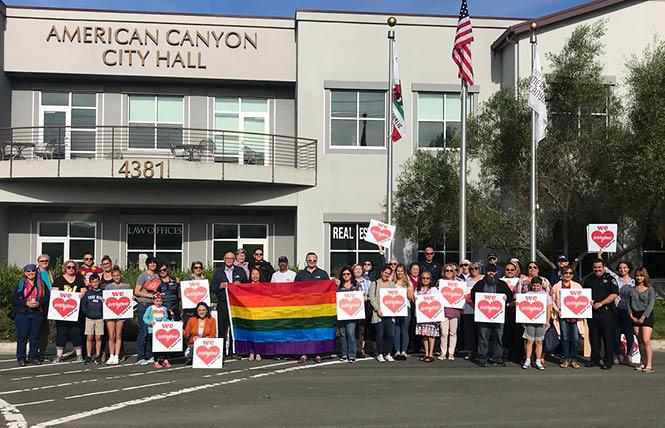City officials and community members gathered in front of American Canyon City Hall to raise the Pride flag. Photo: Courtesy LGBTQ Connection