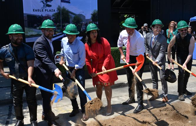 Eagle owner Alex Montiel, left, grabbed a shovel at the groundbreaking for Eagle Plaza, joining Supervisor Rafael Mandelman. Loring Sagan of Build Inc., Mayor London Breed, Supervisor Matt Haney, Victor Ruiz-Cornejo from state Senator Scott Wiener's office, and Bob Goldfarb, president of the Leather and LGBTQ Cultural District. Photo: Bill Wilson