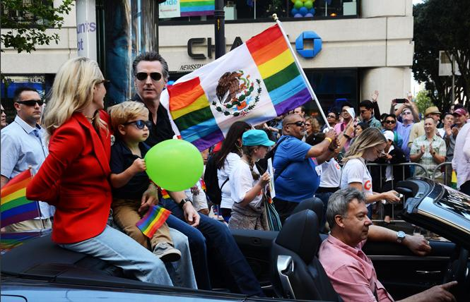 Gavin Newsom, then California's lieutenant governor, and his wife, Jennifer Siebel Newsom, took part in the 2018 San Francisco Pride parade. Photo: Rick Gerharter
