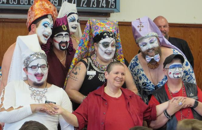 Members of the Russian River Sisters of Perpetual Indulgence appeared on stage just before the start of the June 8 Let's Play Doctor bingo in Guerneville. In back, from left, Sister Frances A. Sissy, Sister Scarlet Billows, Sister Sparkle Plenty, and Aspirant Sharon da Goods. In middle row, from left, Sister Sorenda 'da Booty and Sister Bette Sheezahee. In front, from left, Novice Eliza Mench, a visiting Buddhist nun who declined to provide their name, and Guard Ian Avirtue. Photo: Charlie Wagner