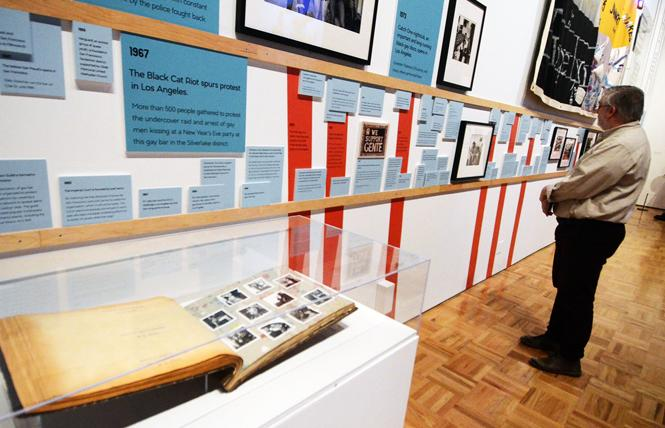"A timeline showing significant events in queer history is part of the Oakland Museum of California's exhibit ""Queer California: Untold Stories."" Photo: Rick Gerharter"