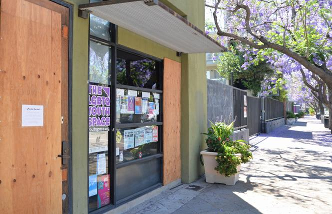 Boards cover the broken windows and door of San Jose's LGBTQ Youth Space, which was vandalized early in the morning June 10. Photo: Jo-Lynn Otto