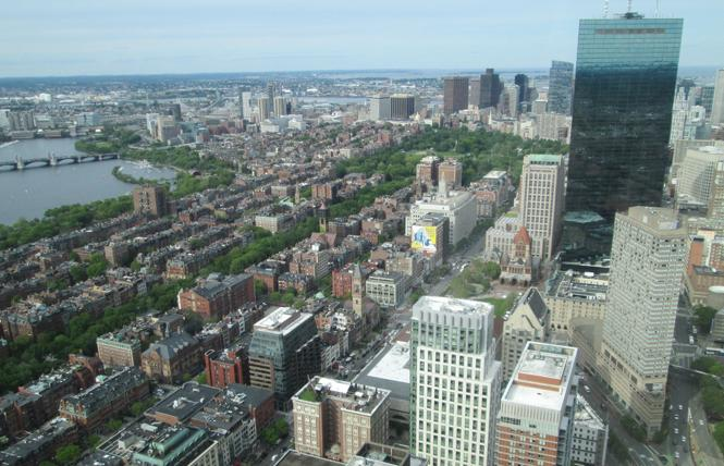 The Boston skyline glistens as seen from the Prudential Skywalk Observatory. Photo: Ed Walsh