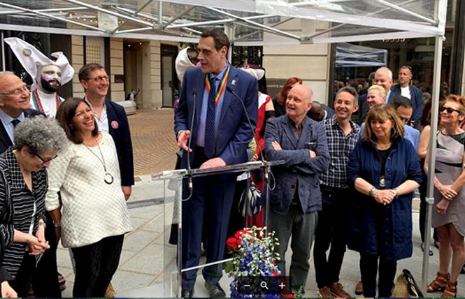 Stuart Milk, center, spoke June 19 in Paris at the Harvey Milk Place renaming ceremony honoring his late uncle, with Paris Mayor Anne Hidalgo and Parisian politicians in the city's 4th arrondissement. Photo: Courtesy the Harvey Milk Foundation