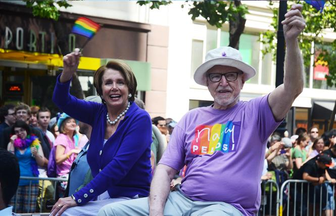 Then-House Minority Leader Nancy Pelosi, left, rode with former ambassador James Hormel in the 2013 San Francisco LGBT Pride parade. Photo: Rick Gerharter