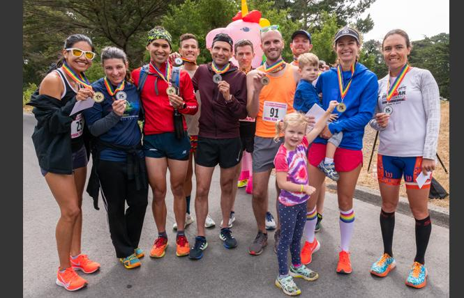 First, second, and third place winners in the 5K and 10K San Francisco Pride Run show off their medals. From left are: Lizeth Aparicio, Angela Knotts, Justin Bandoro, Christopher Kirchhoff, Nick Kovaleski, Freddie Manners, Terence Byrnes, Bryan Eckstein, Suzanne Hyer, and Zuzana Trnovcova. Photo: Jane Philomen Cleland